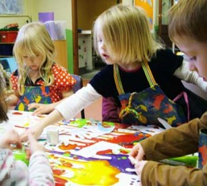 Having fun painting in the pre-school room
