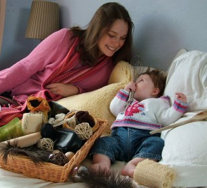 Mother and daughter playing at home with a Treasure Basket