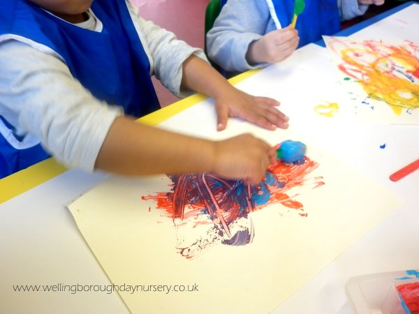 Children painting with frozen paint