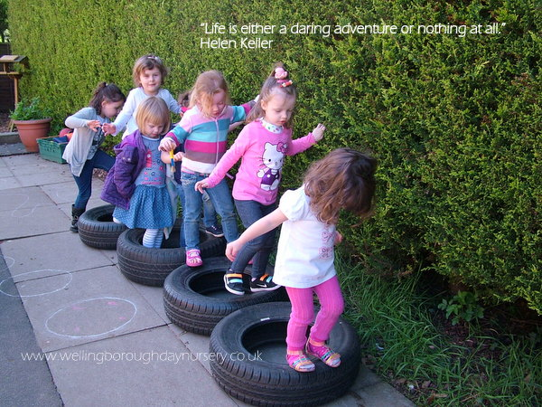 Children balancing on tyres