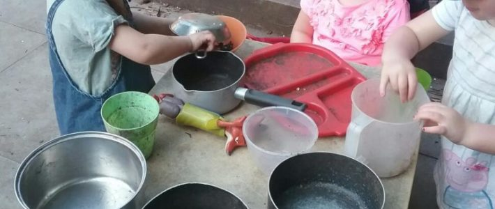 Cooking in the mud kitchen at Wellingborough Day Nursery